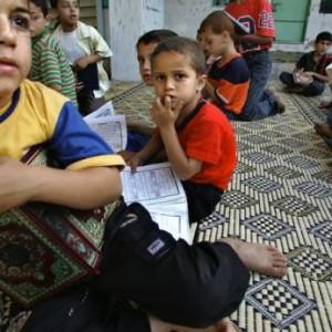 Anak Kecil Di Gaza Sedang Menghafal Al-Qur'an